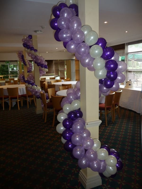 Twisted ropes of balloons coiled around a pillar make a spectacu
