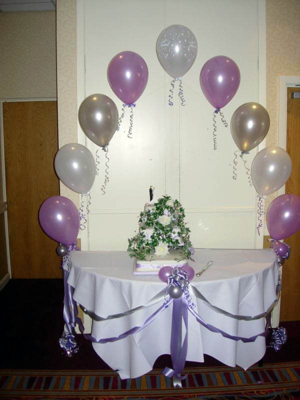 One way to decorate a cake table with a cathedral arch and ribbo