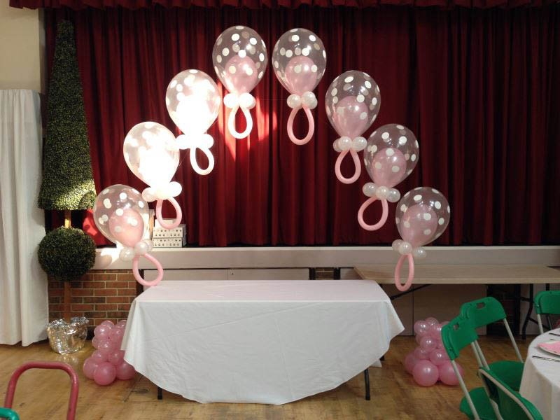 Babies teats made into a balloon arch over the cake table