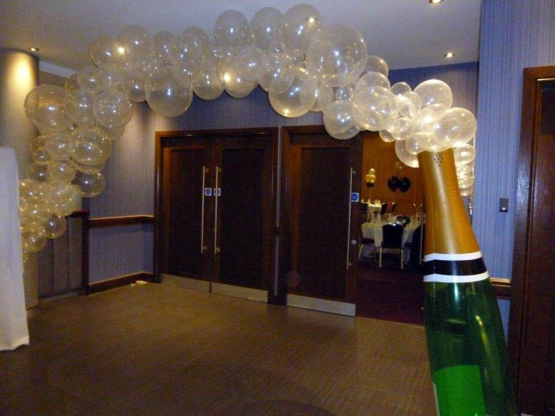 Champagne bottle of balloon bubbles over a doorway makes a WOW f